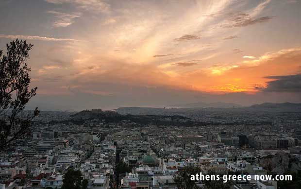 Sunrise over Athens Greece from Lycabettus - Pireaus in distance
