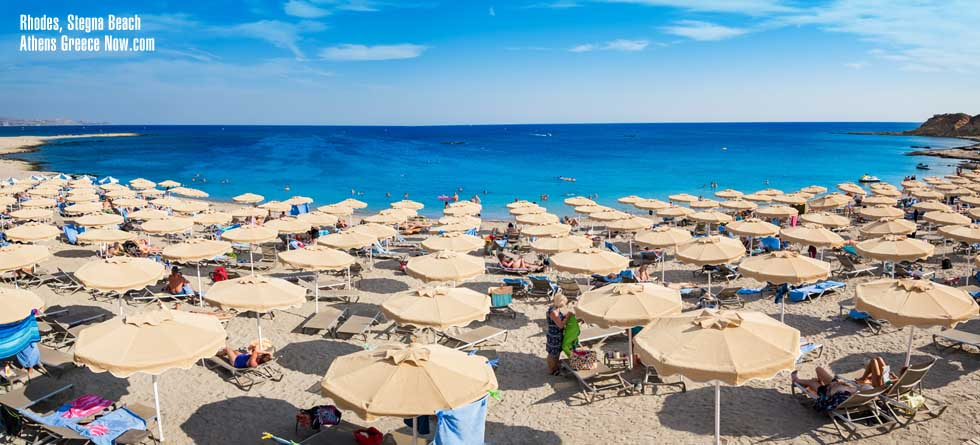 Rhodes Island with Stegna Beach with umbrellas
