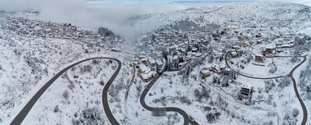 Snowy landscape village in Greece