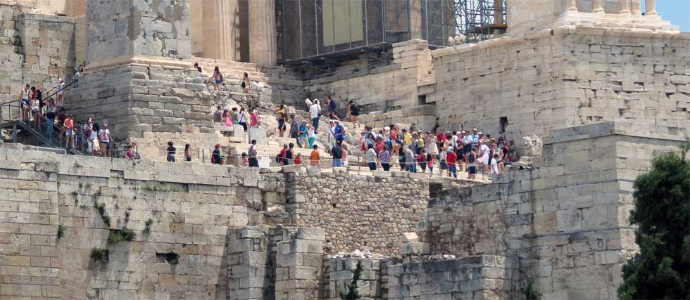 Tourists walking across Acropolis