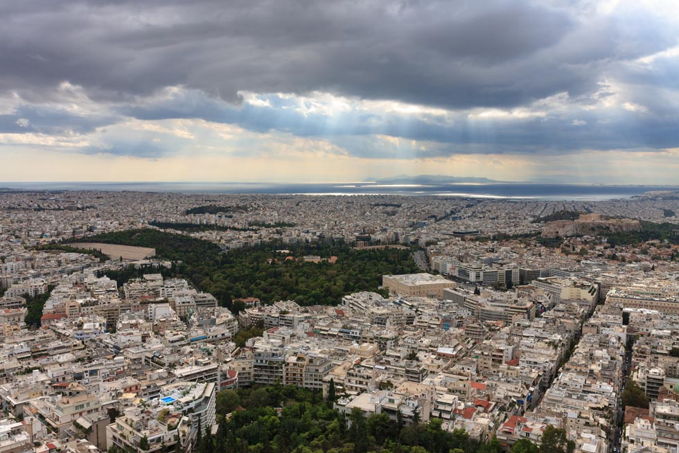 Aerial view over Athens  with Piraeus in distance