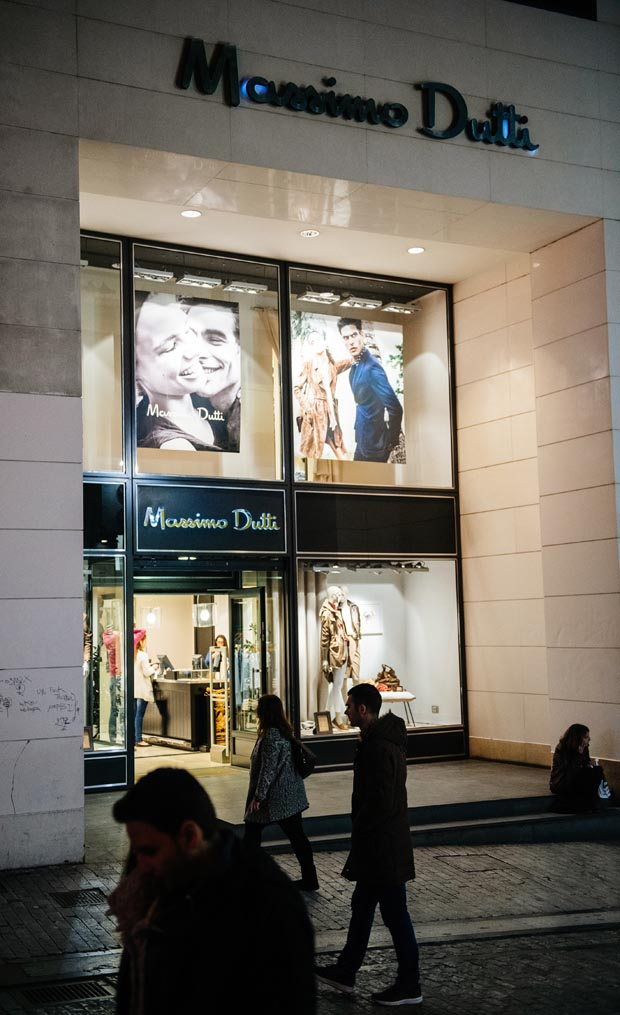 Massimo Dutti luxury store in central Athens at dusk