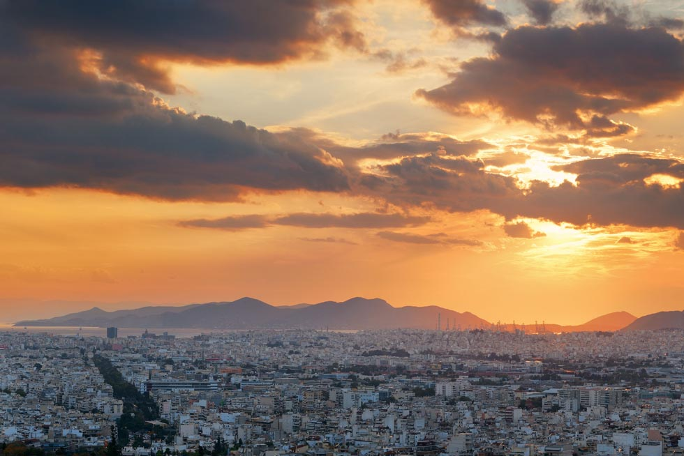 Athens with Piraeus in far distance