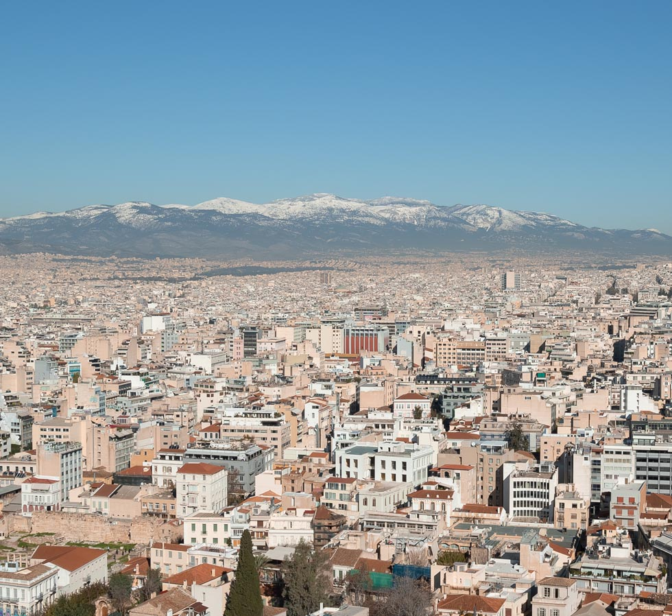 Panoramic of Athens Greece with snow-capped mountains