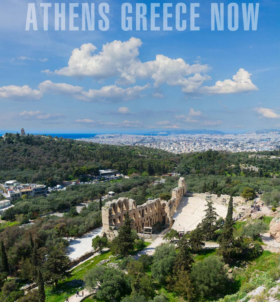 Athens Greece Now -   View of Herodes Atticus amphitheater of Acropolis and blue sky with clouds, Athens, Greece
